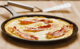 Rustic fried bacon omelette Royalty Free Stock Photo