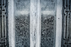 Rustic frosted window with vintage wood frame as Christmas background Royalty Free Stock Image