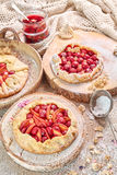 Rustic fruit tarts and meringues, homemade pastry. Stock Images