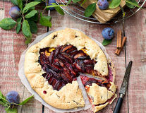 Rustic galette fruit tart with plums and cinnamon Stock Photography