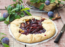 Rustic galette fruit tart with plums and cinnamon Stock Image