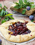 Rustic galette fruit tart with plums and cinnamon Royalty Free Stock Photography