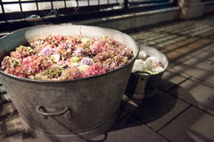 Rustic galvanised pails filled with summer flowers. Assorted summer flowers in a full frame background with hydrangeas and roses viewed close up from above in a royalty free stock images