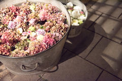 Rustic galvanised pails filled with summer flowers. Assorted summer flowers in a full frame background with hydrangeas and roses viewed close up from above in a stock image