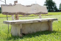Rustic garden bench made of solid wood Royalty Free Stock Photography