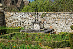 Rustic Garden Well with stone well Stock Images