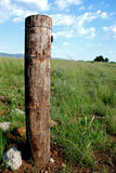 Rustic Gate Post. Image of a rustic wooden gate post and fencing Stock Images