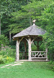 Rustic gazebo. In forested backyard Royalty Free Stock Image
