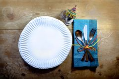 Rustic genuine casual Hanukkah meal place setting with handmade plate and enameled dreidel. Horizontal aspect Royalty Free Stock Image