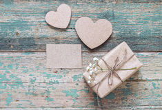 Rustic gift box with flower and hearts on the old grunge painted Royalty Free Stock Photo