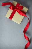 Rustic gift box with red ribbon. With copy space royalty free stock photography