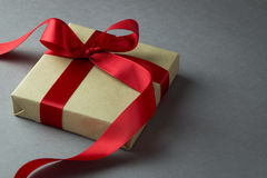 Rustic gift box with red ribbon. With copy space stock photos