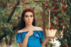 Summer Fashion Girl Holding Cherry Basket stock photos