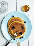 Rustic golden blueberry pancake Stock Photo