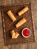 Rustic golden chinese spring rolls. Close up of rustic golden chinese spring rolls Royalty Free Stock Image