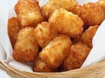 Rustic golden potato tater tots Stock Image