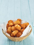 Rustic golden potato tater tots Stock Photography