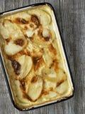 Rustic golden scalloped potato gratin dauphinois Royalty Free Stock Image