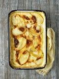Rustic golden scalloped potato gratin dauphinois. Close up of rustic golden scalloped potato gratin dauphinois Royalty Free Stock Image