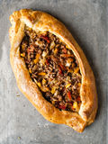 Rustic golden turkish pide bread pizza Stock Image