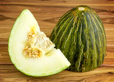 Rustic gourmet christmas melon on wooden background Royalty Free Stock Photos