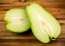 Rustic gourmet food shot of delicious ripe chayote choko fruit Stock Images