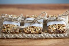 Rustic Granola Bars wrapped with Twine on Burlap Blue BG Stock Photography