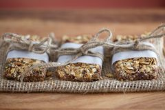 Rustic Granola Bars wrapped with Twine on Burlap Red BG Royalty Free Stock Photography