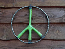 Rustic Green Peace Symbol Hanging on Wall Royalty Free Stock Photography