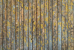 Rustic grey wood background with traces of yellow peeled paint. Stock Images