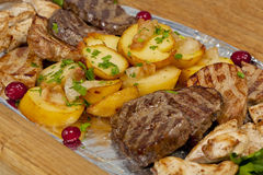 Rustic grilled beef steak with potatoes. And sauce Royalty Free Stock Photos