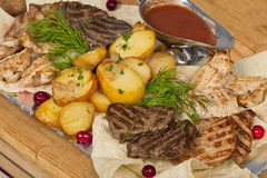 Rustic grilled beef steak with potatoes Royalty Free Stock Photography