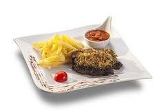 Rustic grilled beefsteak with french fries and spicy sauce. Isolated on white plate stock images