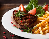 Rustic grilled steak with french fries Royalty Free Stock Image