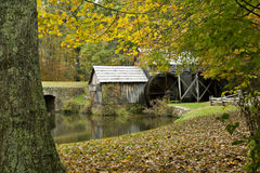 Rustic gristmill in Fall season Royalty Free Stock Image
