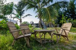 Rustic group of chairs and table made of bamboo in lush green surroundings at coast of Senegal, Africa Royalty Free Stock Photography