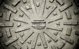 Rustic grunge manhole cover texture Stock Images