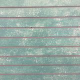 Rustic grungy urban slat wall in green and grey Royalty Free Stock Photos