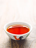 Rustic gyoza red chili oil dipping sauce Royalty Free Stock Image