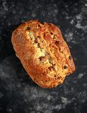 Rustic hand made organic bloomer bread with cranberry, raisin and cashew.  Royalty Free Stock Images
