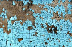 Rustic hardboard texture with scratches, cracks and blue peeling paint. Grunge background Stock Image