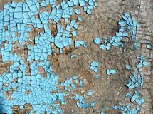 Rustic hardboard texture with scratches, cracks and blue peeling paint. Grunge background Royalty Free Stock Photos