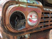 Rustic headlight. Old rustic headlight out that smiles Stock Image