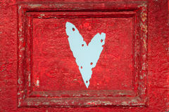 Rustic heart on door Royalty Free Stock Images