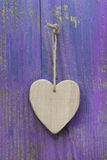 Rustic heart on purple wooden surface for valentine, birthday, m Stock Photo