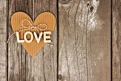 Rustic heart shaped gift tag with LOVE wood letters Royalty Free Stock Photo