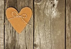 Rustic heart shaped gift tag on a wood background Stock Image