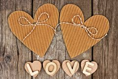 Rustic heart shaped gift tags with LOVE wood letters Stock Image