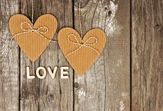 Rustic heart shaped gift tags with LOVE wood letters Royalty Free Stock Photo