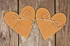 Rustic heart shaped gift tags with LOVE wood letters Royalty Free Stock Image